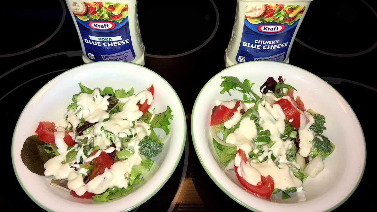 two bowls of salad used for comparing Kraft Roka Blue Cheese dressing vs Kraft Chunky Blue Cheese dressing
