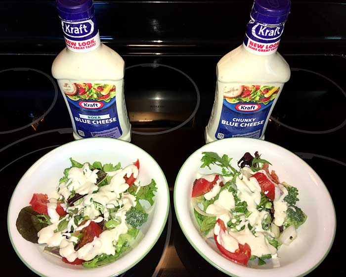Roka Blue Cheese and Chunky Blue Cheese on salads in salad bowls