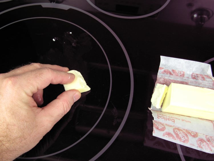 rubbing butter on the glass-top stove for the cleaning cloth test
